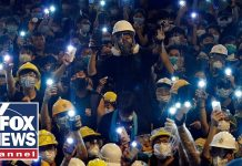 Thousands swarm police headquarters in Hong Kong
